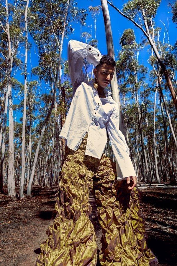 Shirt by Nessie Croft, pants by Madeleine Jost, earrings by Charmaine De Lima