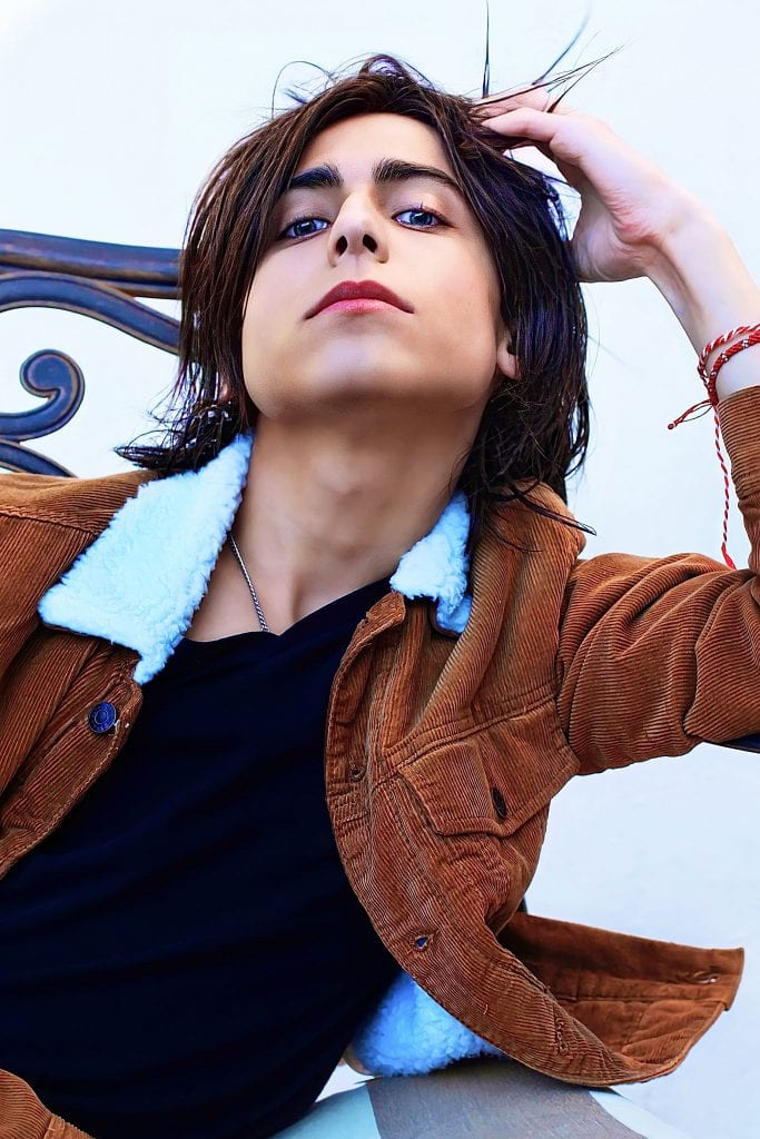 Aidan Gallagher: brown jacket