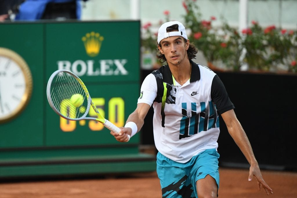 Lorenzo Musetti playing tennis by Peter Staples / ATP Tour