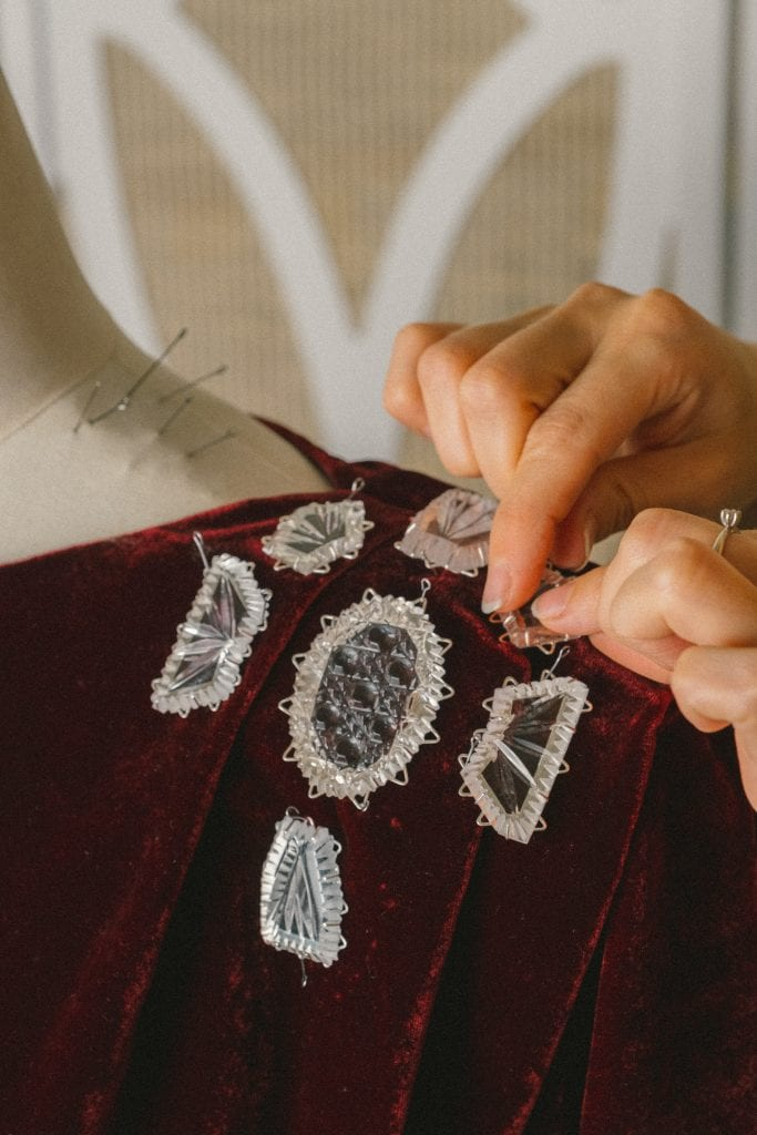 The process of tacking Gus Khrustalny crystal pieces on a dress at Ulyana Sergeenko's atelier in Moscow ©Ulyana Sergeenko