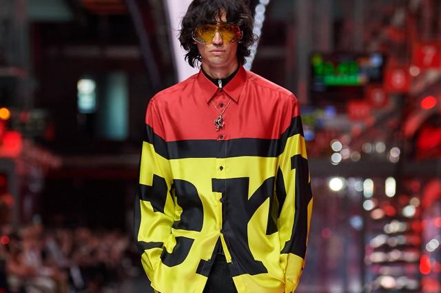 model wearing a shirt with Ferrari written on it