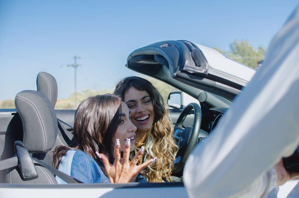 Tini & María Becerra in a car
